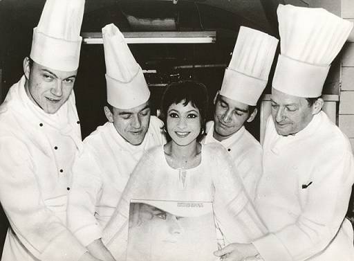 Esther Ofarim surrounded by cooks